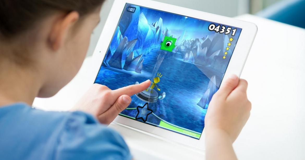 Child playing game on iPad