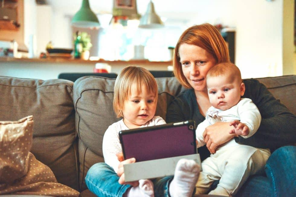 Mother and children using a handheld device