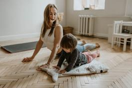 Woman and child doing yoga